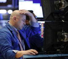 US stocks tumble amid global sell-off; Dow falls 325