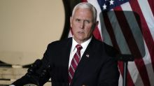After Trump praise, Pence decries QAnon 'conspiracy theory'