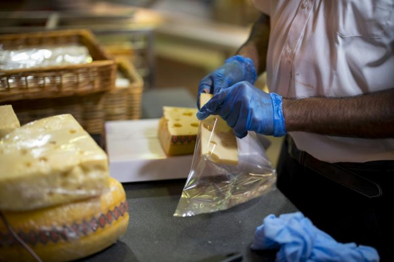 The cheese shop reportedly stocks around 200 types of cheese and is maturing up to three tons of cheese on the premises (AFP Photo/TOLGA AKMEN)