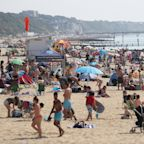 Beach-goers camp overnight in Dorset as councils across England warn coastline is 'extremely busy'