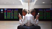 Share market edges higher, $A gets a boost