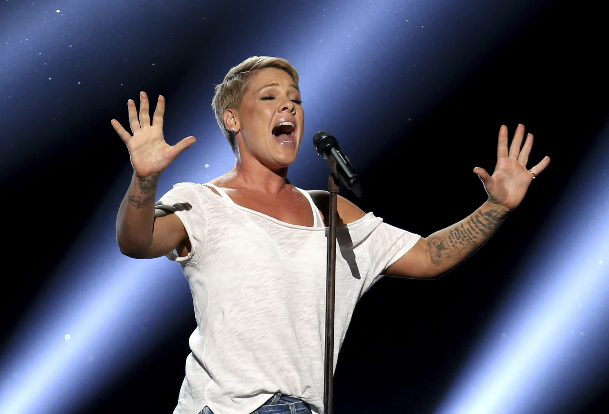 "FILE - In this Jan. 28, 2018, file photo, Pink performs ""Wild Hearts Can't Be Broken"" at the 60th annual Grammy Awards at Madison Square Garden in New York. The spreading coronavirus might have canceled several touring performances from A-list musical artists, but those acts have found a new venue to sing: their living rooms. Pink, John Legend, Bono, Coldplay's Chris Martin, John Mayer, Keith Urban and others have held virtual concerts from their homes as the world continues to practice social distancing to slow the spread of the virus. (Photo by Matt Sayles/Invision/AP, File)"