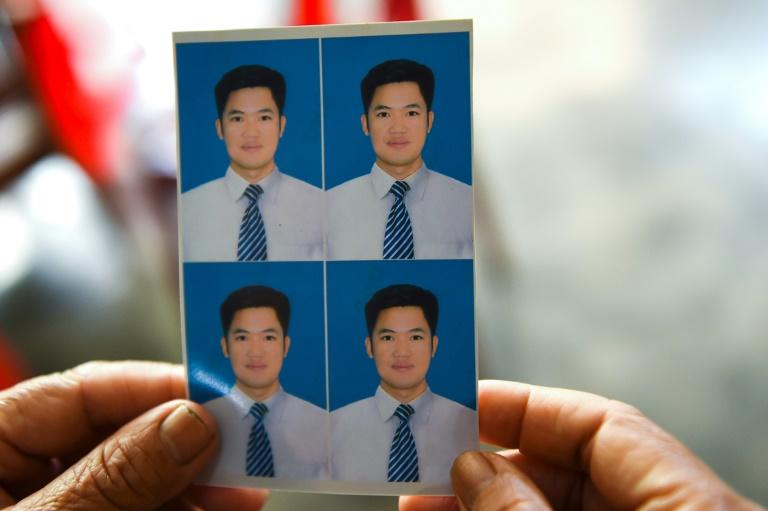 Nguyen Van Hung got a falsified passport in 2018 and took off without telling his parents (AFP Photo/Nhac NGUYEN)