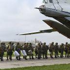 Russia orders troop pullback but keeps weapons near Ukraine