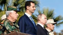On Mideast trip, Putin orders partial withdrawal from Syria