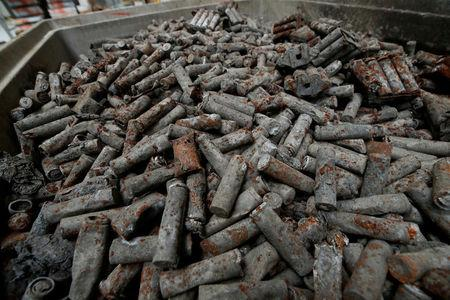 FILE PHOTO: Pyrolised Lithium-ion accus of laptops, smartphones and accu-powered craftsmen tools are pictured at the German recycling firm Accurec in Krefeld, Germany, November 16, 2017. REUTERS/Wolfgang Rattay /File Photo