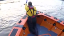 Dramatic moment heroic lifeboat crew rescues man 'five seconds away from drowning' in River Thames