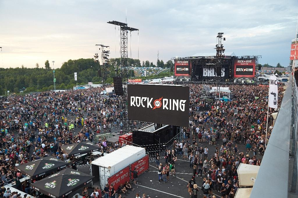 Festival goers leave the venue of the Rock am Ring music festival on June 2, 2017 in Nuerburg following an evcuation alert