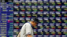 Asian shares perk up after US Senate passes budget plan
