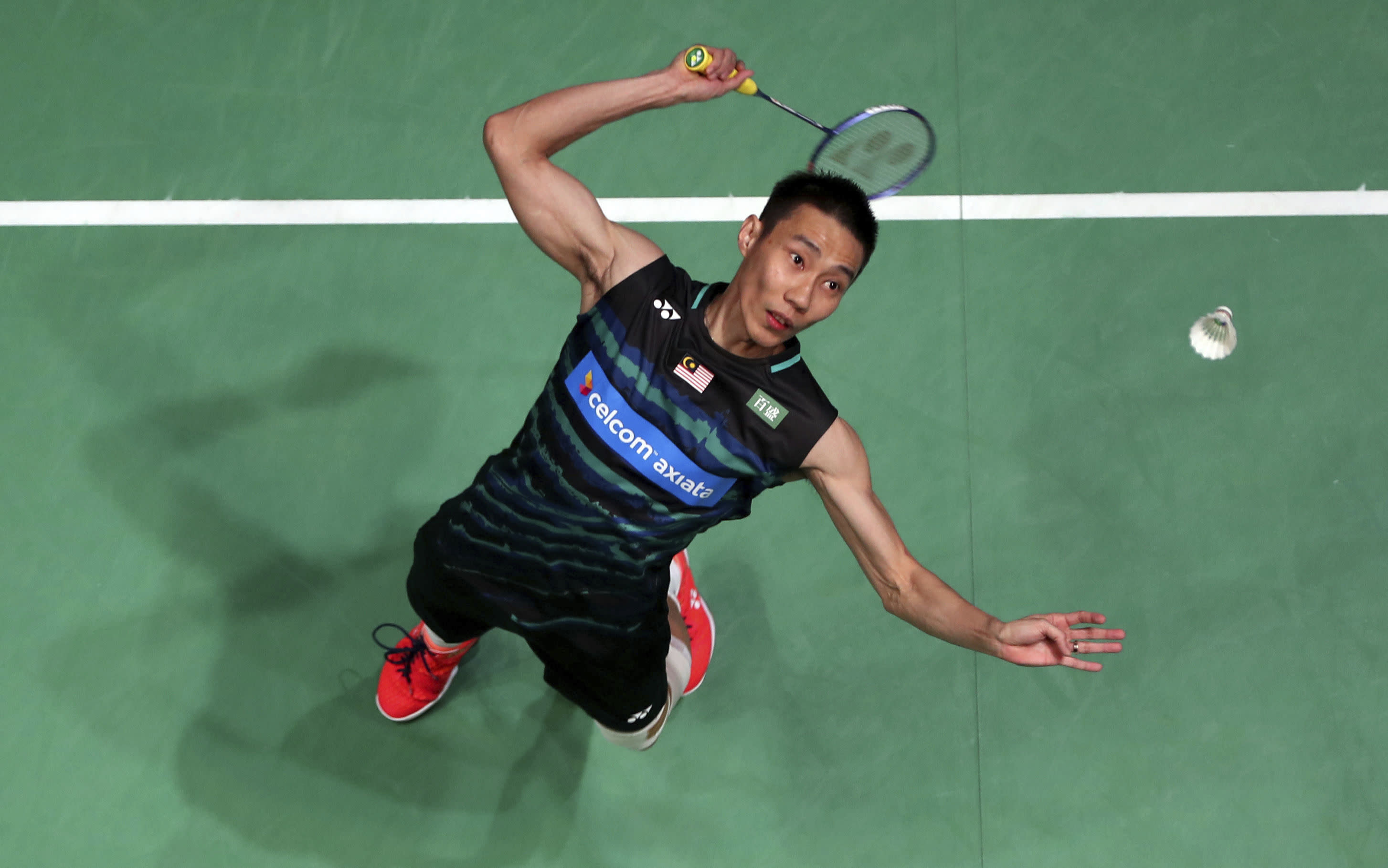 Olympic badminton champ upset by Thai at All England Open