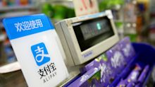 China mobile payment giants Alipay, WeChat open to international cards