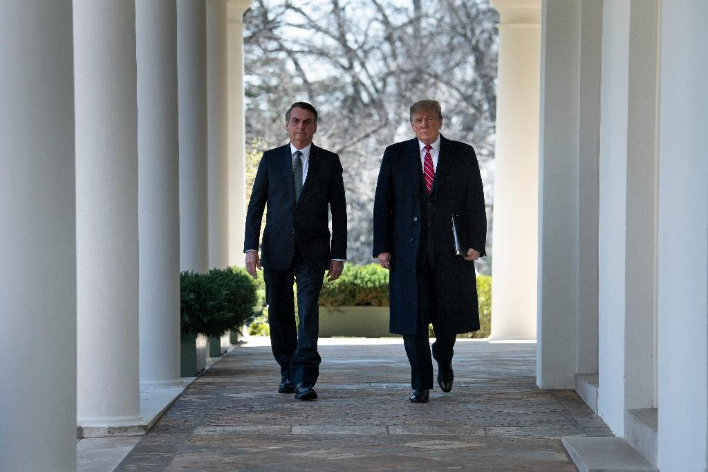 Brazil's President Jair Bolsonaro and US President Donald Trump announced a special relationship at their first joint press conference in the White House's Rose Garden. (AFP Photo/Brendan Smialowski)