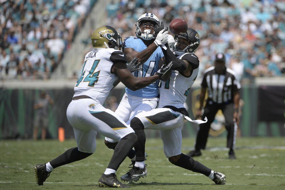Jacksonville Jaguars outside linebacker Myles Jack (44) and cornerback A.J. Bouye (21) break up a pass. (AP)