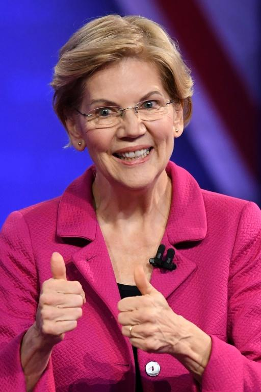 By connecting with voters and releasing several progressive policy plans, US Senator Elizabeth Warren has gained ground on the onetime clear frontrunner for the 2020 Democratic presidential nomination, Joe Biden, and the two are about even in polling (AFP Photo/Robyn Beck)