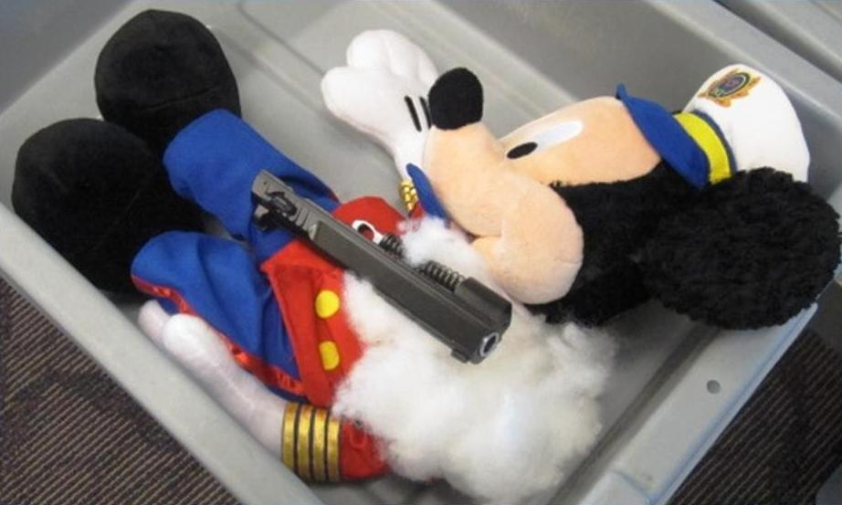 """This undated photo provided by the federal Transportation Security Administration shows pistol parts hidden in a stuffed animal found by TSA officials at T.F. Green Airport in Warwick, R.I., Monday May 7, 2012. The TSA said Tuesday that a man traveling to Detroit with his 4-year-old son was stopped when a TSA officer noticed the disassembled gun components """"artfully concealed"""" inside three stuffed animals. The stuffed animals were inside a carry-on bag that was put through an x-ray machine as part of normal security screening. (AP Photo/Transportation Security Administration)"""