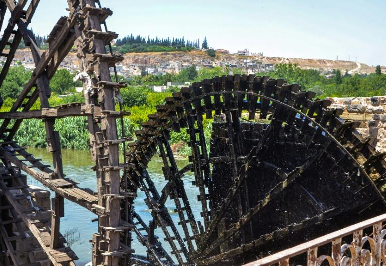 """The water wheels or """"norias"""" of Hama were used for centuries to bring water to gardens and buildings on the shores of the Orontes River (AFP Photo/MAHER AL MOUNES)"""