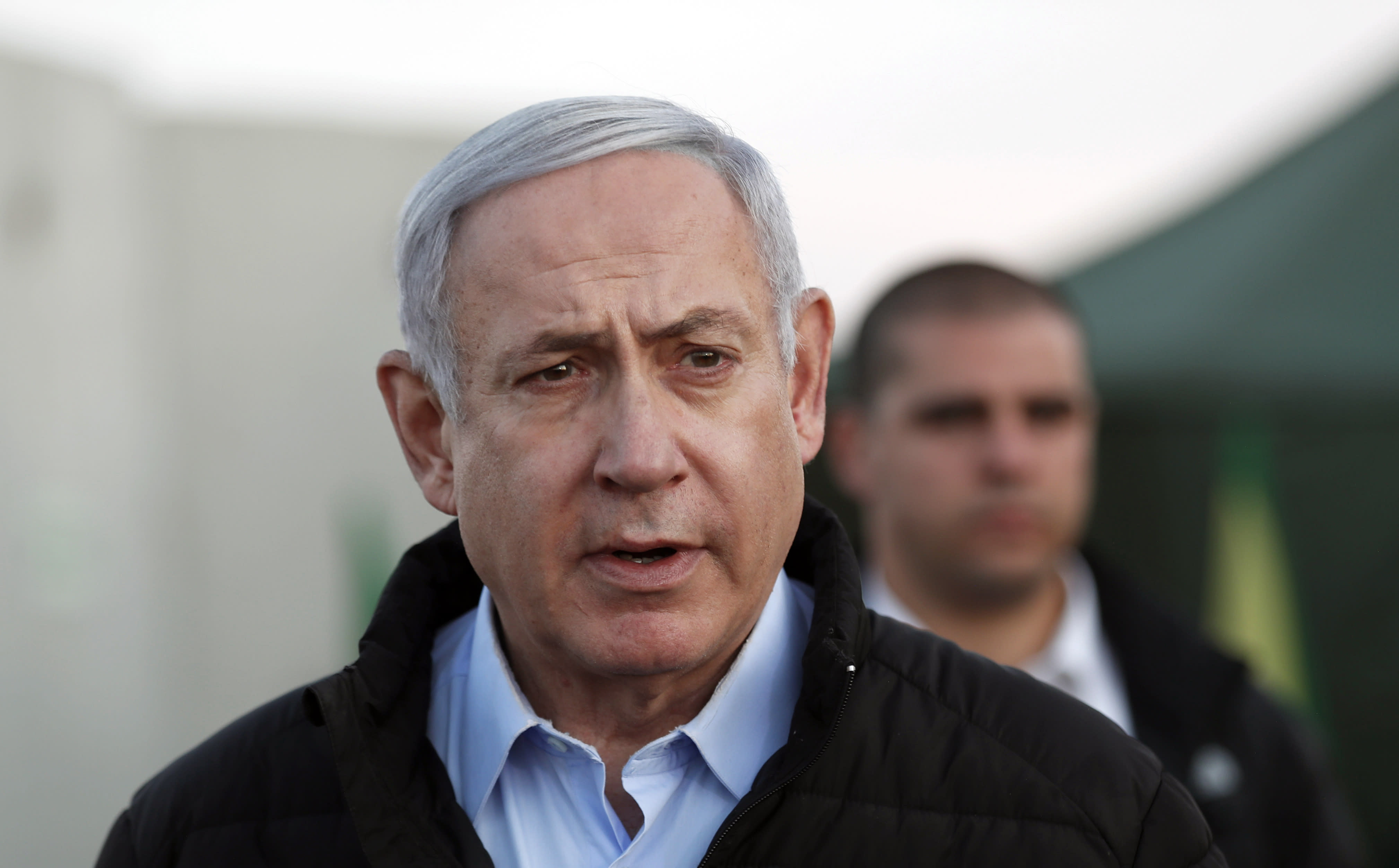 FILE - in this Nov. 24, 2019 file photo, Israeli Prime Minister Benjamin Netanyahu, looks on during a visit to Israeli army base in the Golan Heights located on the Israeli-Syrian border. Barring a nearly unfathomable about face, Israel is headed Wednesday, Dec. 11 toward an unprecedented third election within a year - prolonging a political stalemate that has paralyzed government and undermined its citizens' faith in the democratic process. (AP Photo/Atef Safadi, File)
