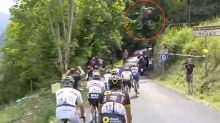 Crazy moment rider JUMPS over Tour de France peloton