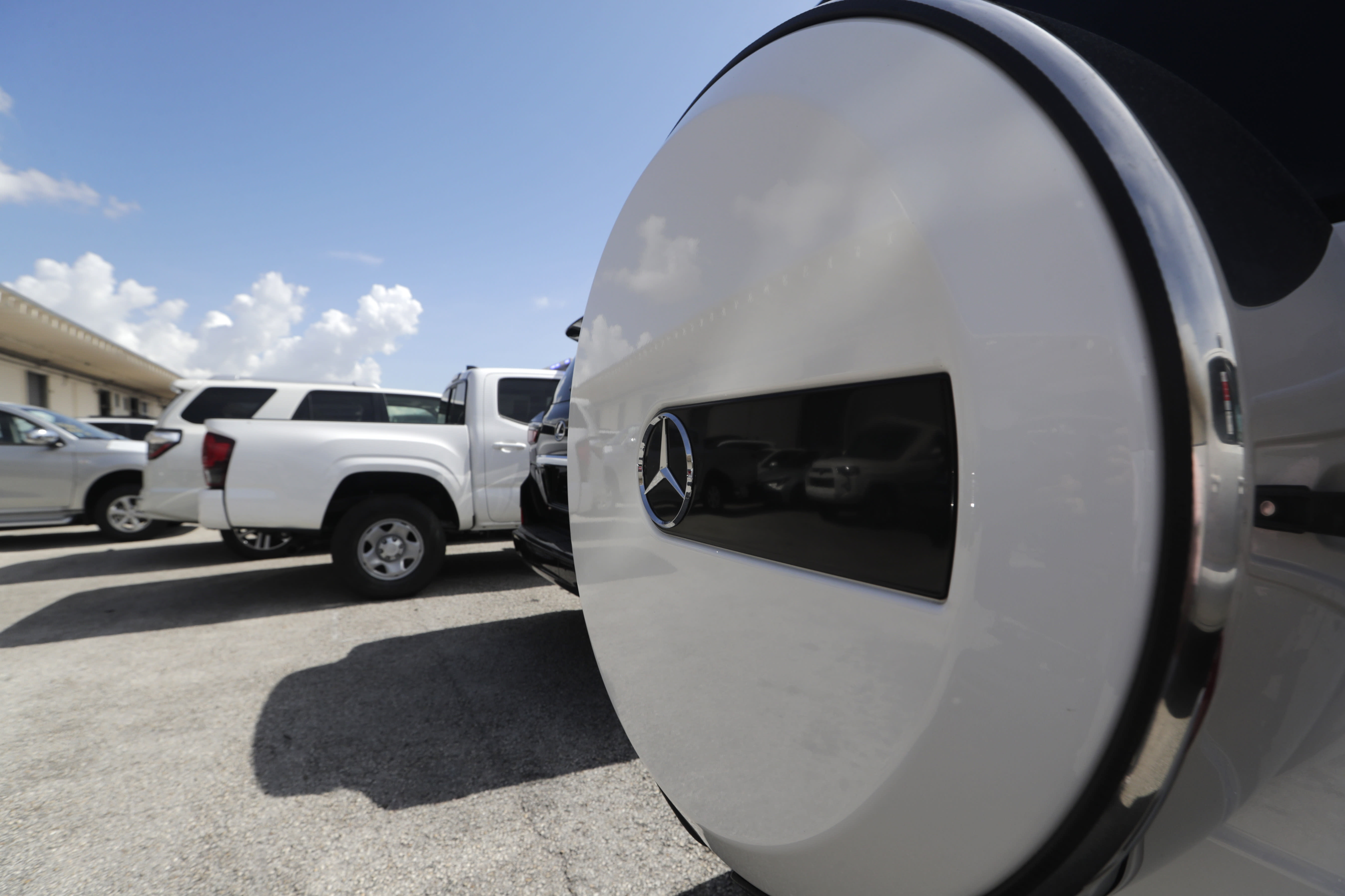 A Mercedes-Benz SUV sits among vehicles worth an estimated $3.2 million, at Port Everglades after they were seized by Homeland Security Investigations, Wednesday, July 8, 2020, in Fort Lauderdale, Fla. The vehicles were to be smuggled to Venezuela in violation of U.S. export laws and sanctions against the socialist Venezuelan Government. (AP Photo/Lynne Sladky)