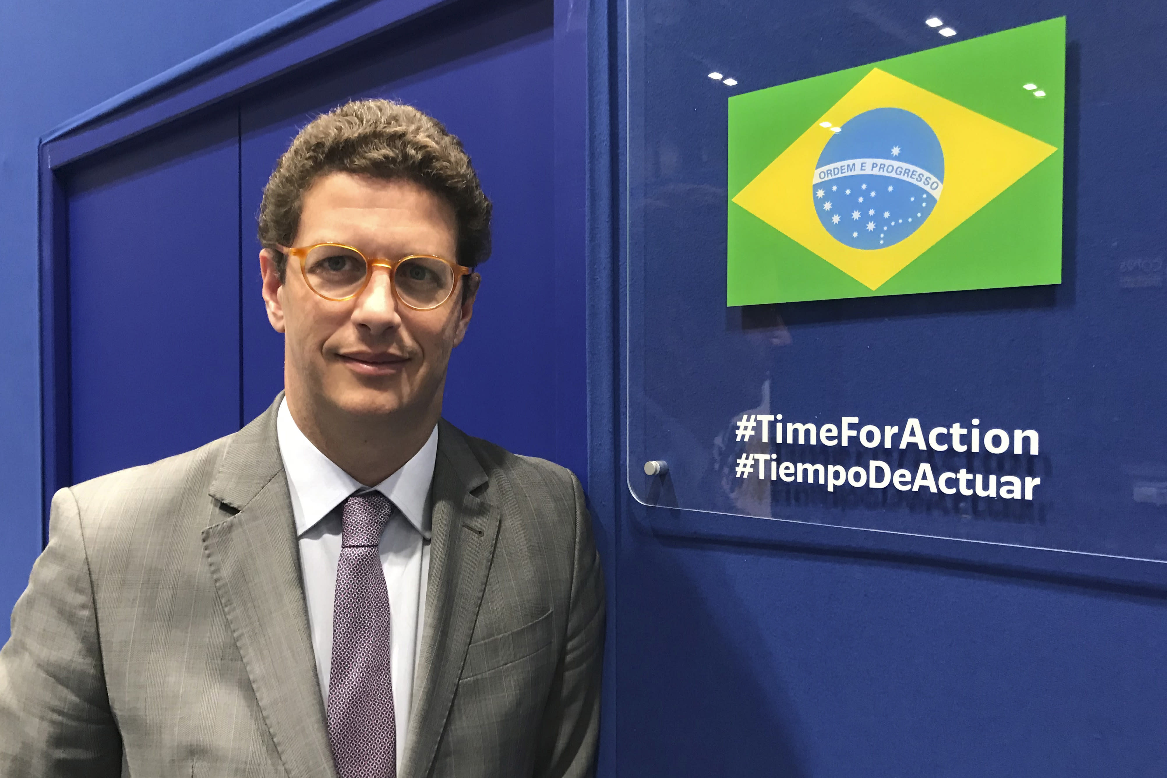 In this photo taken on Saturday Dec. 7, 2019, Brazilian environment Ricardo Salles stands outside the Brazil delegation room at the COP25 U.N. climate talks in Madrid, Spain. Madrid is hosting a two-week global summit aimed at lessening the impact of rising temperatures. (AP Photo/Dorothee Thiesing)