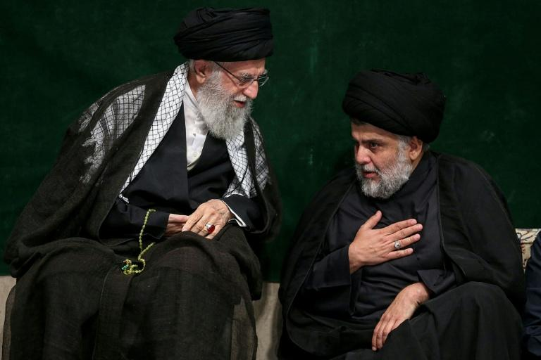 Iran's supreme leader Ayatollah Ali Khamenei (L) speaking with Iraqi Shiite cleric, politician and militia leader Moqtada al-Sadr during a religious ceremony in the capital Tehran (AFP Photo/-)
