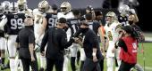 Las Vegas Raiders head coach Jon Gruden, left, bumps fists with New Orleans Saints head coach Sean Payton after Monday's game. (AP)