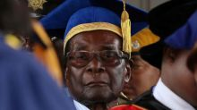 Zimbabwe's Mugabe digs in heels as ruling party moves to depose him