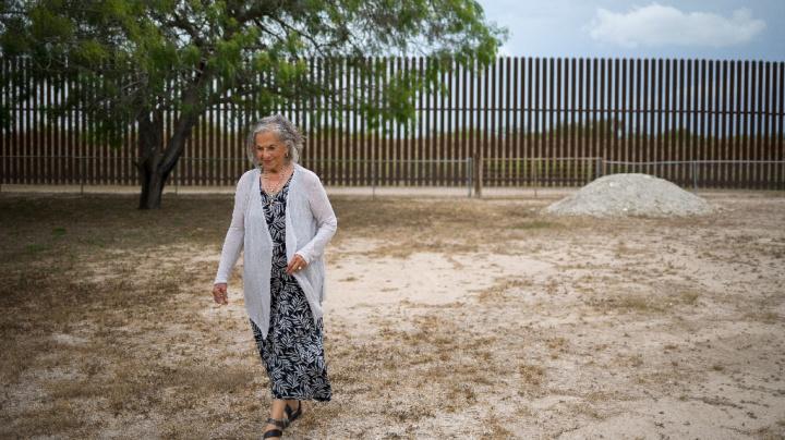 Apache woman has key to border wall gate