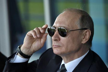 Russian President Vladimir Putin watches a display during the MAKS 2017 air show in Zhukovsky