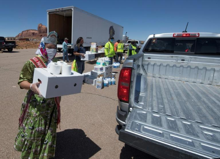 Miss Navajo Nation Shaandiin Parrish delivers food and household items to families in need outside Monument Valley Tribal Park (AFP Photo/Mark RALSTON)