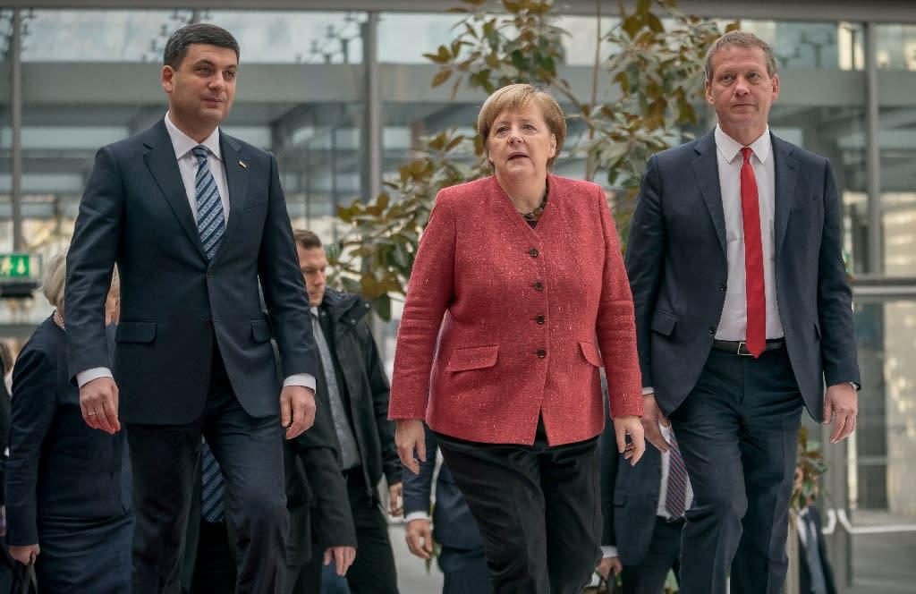 German Chancellor Angela Merkel met with Ukrainian Prime Minister Volodymyr Groysman, left, but showed no sign of backing military support (AFP Photo/Michael Kappeler)