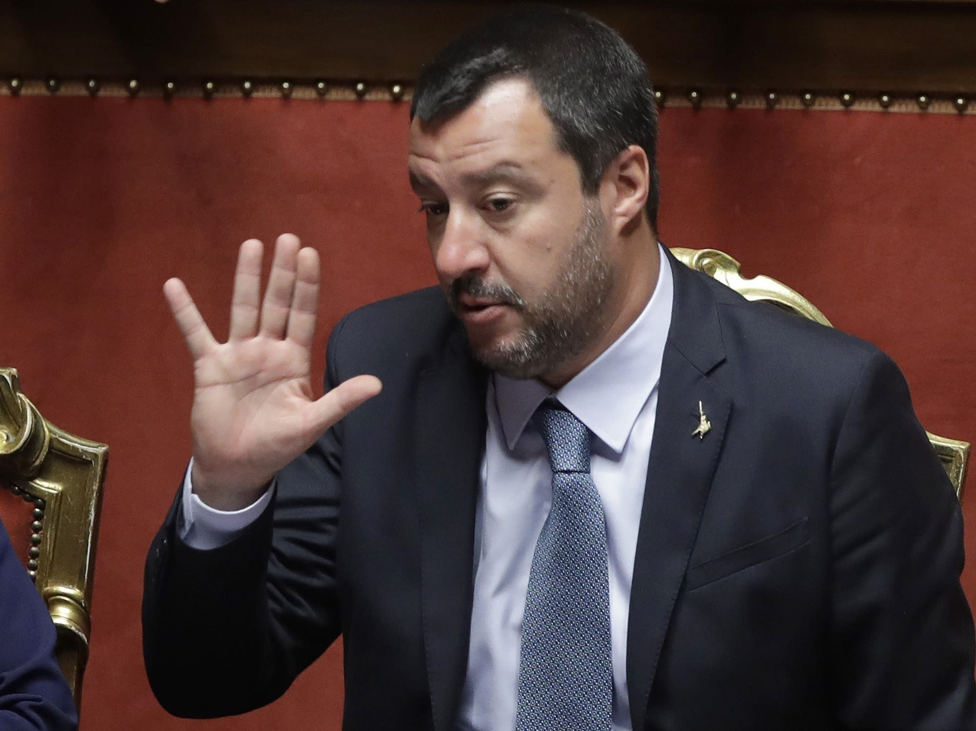 FILE - In this March 20, 2019, photo, Italian Interior Minister and Vice Premier Matteo Salvini gestures at the Italian Senate in Rome. Migrants hijacked a cargo ship in Libyan waters on Wednesday March 27, 2019, and have forced the crew to reroute the vessel north toward Europe, and Italian Interior Minister Salvini said the ship, was carrying around 120 migrants, but Italian authorities vowed they would not allow it into their territorial waters. (AP Photo/Alessandra Tarantino, File)