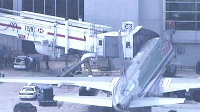 Passenger restrained on flight to Miami arrested