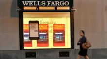 Investors keep Wells Fargo board at contentious meeting