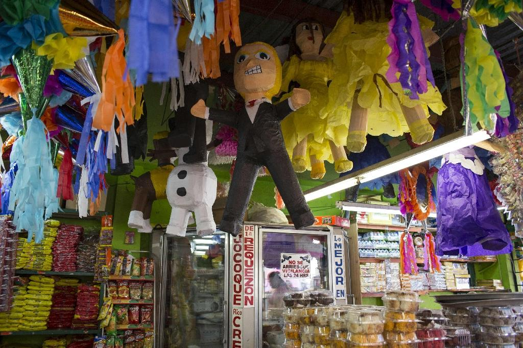 A pinata of US Republican presidential candidate Donald Trump is displayed for sale in Tijuana, northwestern Mexico (AFP Photo/Jose Rivera)