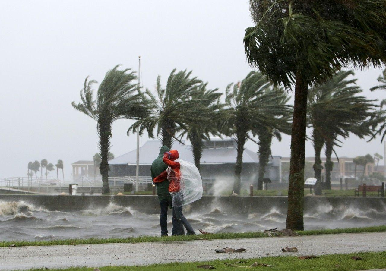 <p>A couple walk along the Sanford Riverwalk along Lake Monroe as strong winds and rain continue from Hurricane Matthew in downtown Sanford, Fla., on Friday, Oct. 7, 2016. (Photo: Jacob Langston/Orlando Sentinel via AP) </p>