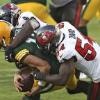 Tom Brady, Bucs defense lay waste to hot start by Aaron Rodgers, Packers
