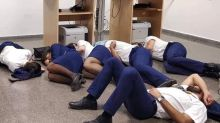 Airline says photo of crew members sleeping on floor after flight cancellation is 'fake news'