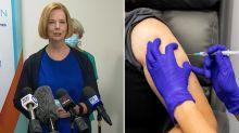 'Step forward': Julia Gillard makes vaccine plea in surprise appearance