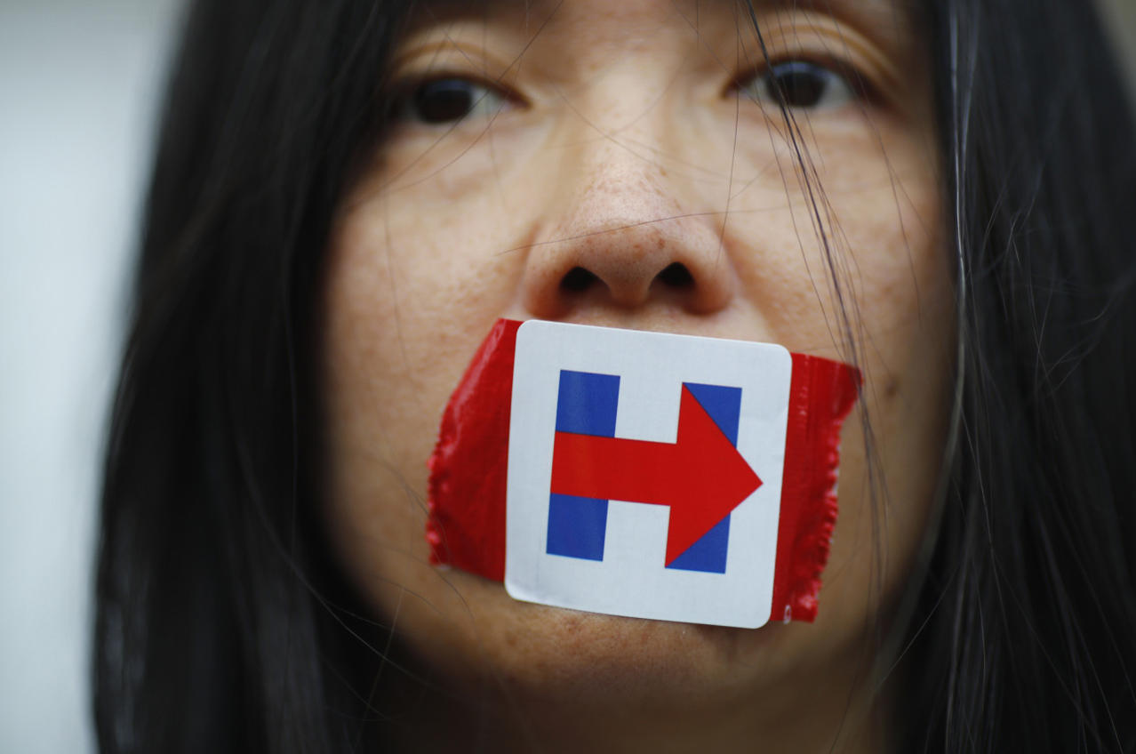 <p>A former Bernie Sanders delegate wears a Hillary Clinton presidential campaign sticker over her mouth as she protests during the third session at the Democratic National Convention in Philadelphia, Pa., July 27, 2016. (Photo: Carlos Barria/Reuters)</p>
