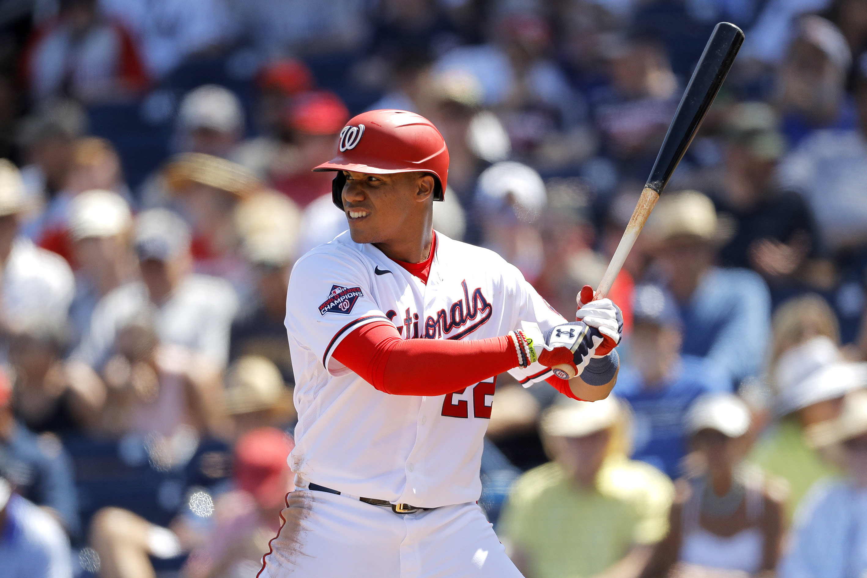 FILE - In this March 12, 2020, file photo, Washington Nationals' Juan Soto waits for a pitch from the New York Yankees during the fourth inning of a spring training baseball game, in West Palm Beach, Fla. Baseball begins Thursday, July 23, 2020, with the New York Yankees at Washington Nationals. Juan Soto and Washington open their title defense after winning the World Series for the first time in franchise history. Gerrit Cole is hoping to lead New York to its 28th championship after the ace right-hander signed a blockbuster deal with the Yankees in free agency. (AP Photo/Julio Cortez, File)
