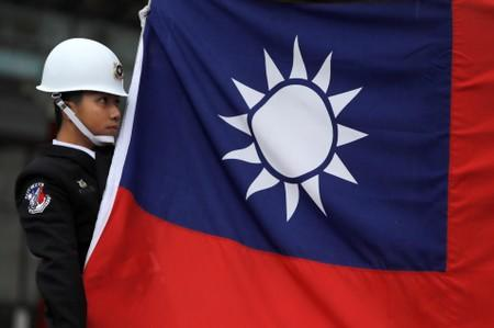 China says will freeze out US companies that sell Taiwan arms