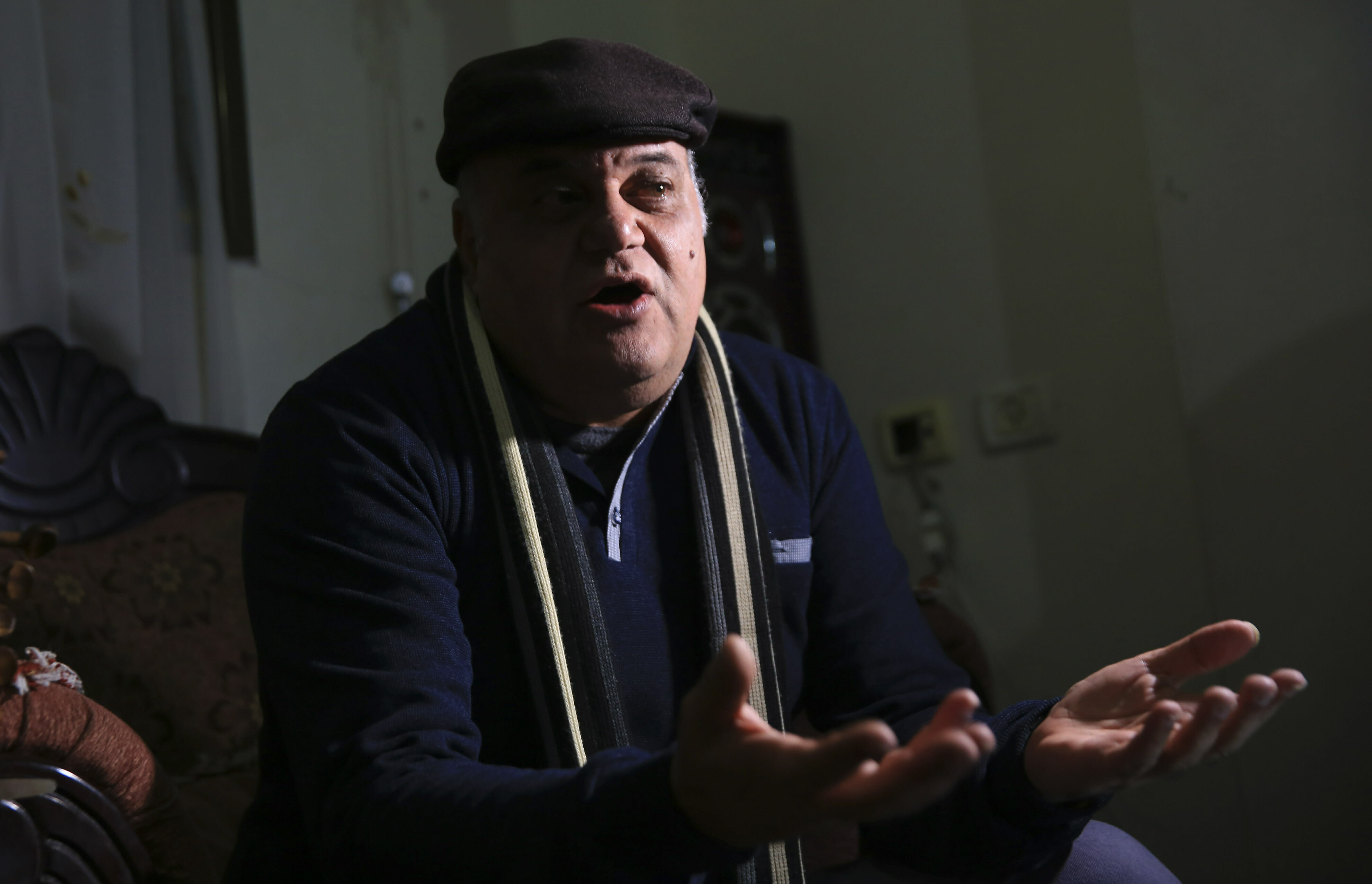 """In this Tuesday, Jan. 29, 2019 photo, Palestinian actor and playwright Ali Abu Yaseen gives an interview in his home at the Shati refugee camp in Gaza City. A new documentary called """"Gaza"""" is hitting the screens at the prestigious Sundance Film Festival this week, providing a colorful glimpse of life in the blockaded Hamas-ruled territory. But one of its main subjects, Abu Yaseen, won't be attending the gathering due to the very circumstances depicted in the film. (AP Photo/Adel Hana)"""