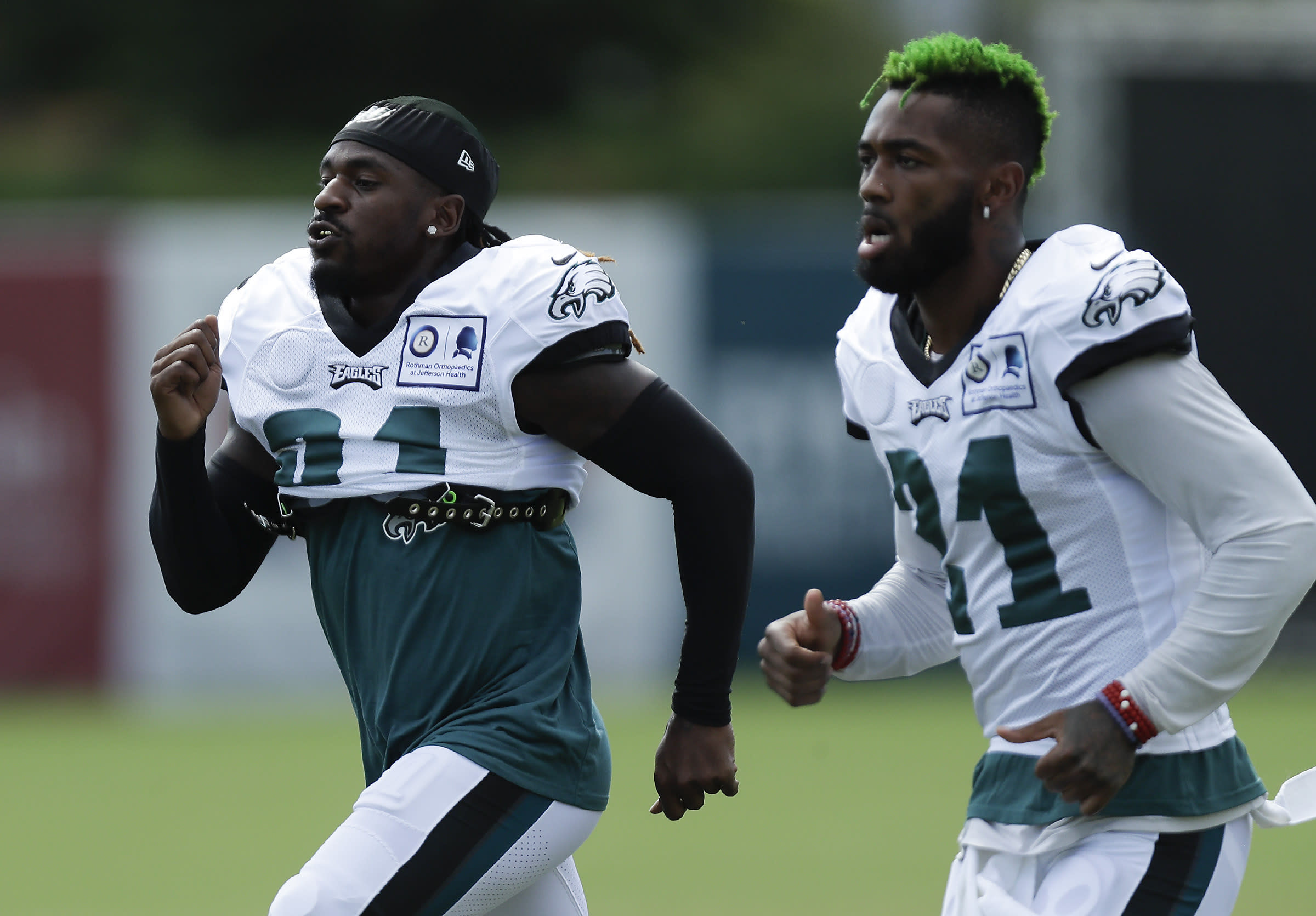 Philadelphia Eagles cornerback Nickell Robey-Coleman, left, runs with teammate safety Jalen Mills during an NFL football training camp practice in Philadelphia, Monday, Aug. 24, 2020. (Yong Kim/Pool Photo via AP)