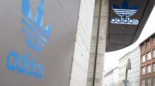 Adidas stops 1 billion euros share buyback