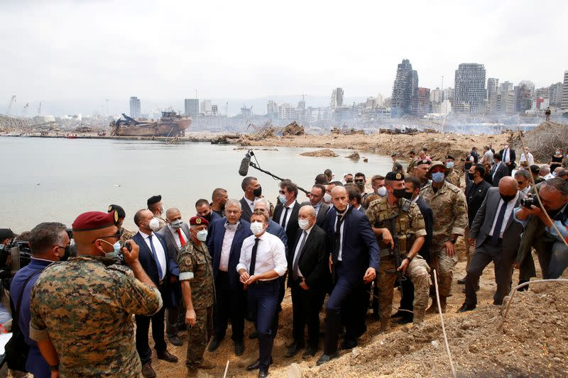 French President Emmanuel Macron visits the devastated site of the explosion at the port of Beirut