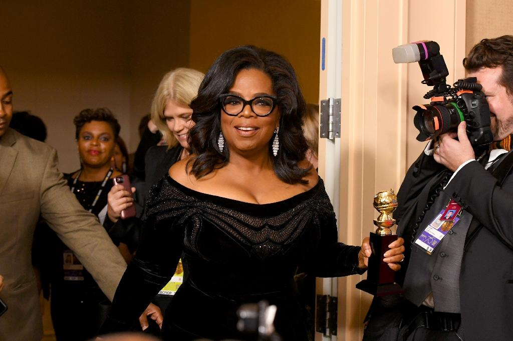 Actress and TV talk show host Oprah Winfrey delivered a rousing, campaign-style speech as she accepted a Golden Globe for lifetime achievement (AFP Photo/KEVIN WINTER)