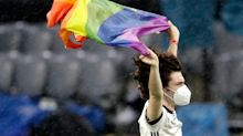 Fan runs on field with rainbow flag during Hungarian anthem amid LGBTQ controversy at Euro 2020