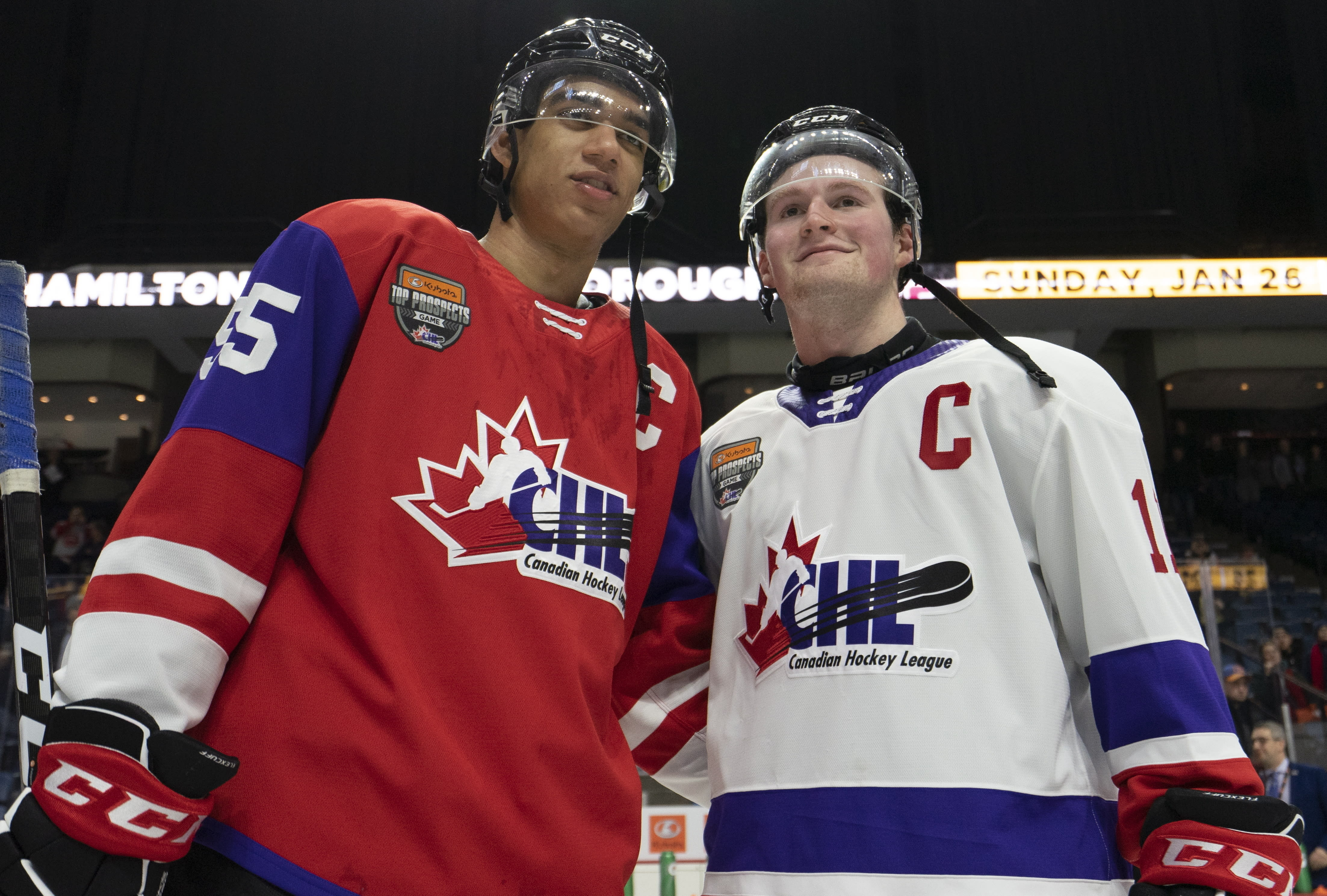 FILE - In this Jan. 16, 2020, file photo, Team Red center Quinton Byfield (55) and Team White left winger Alexis Lafreniere (11) pose for photos following hockey's CHL Top Prospects Game in Hamilton, Ontario. The New York Rangers might be on the clock in owning the No. 1 pick in the NHL draft on Tuesday, Oct. 6. That, and the prospect of selecting Quebec star forward Alexis Lafreniere, doesn't mean the still-retooling Rangers will be anywhere closer to being a contender, team president John Davidson cautions. (Peter Power/The Canadian Press via AP)