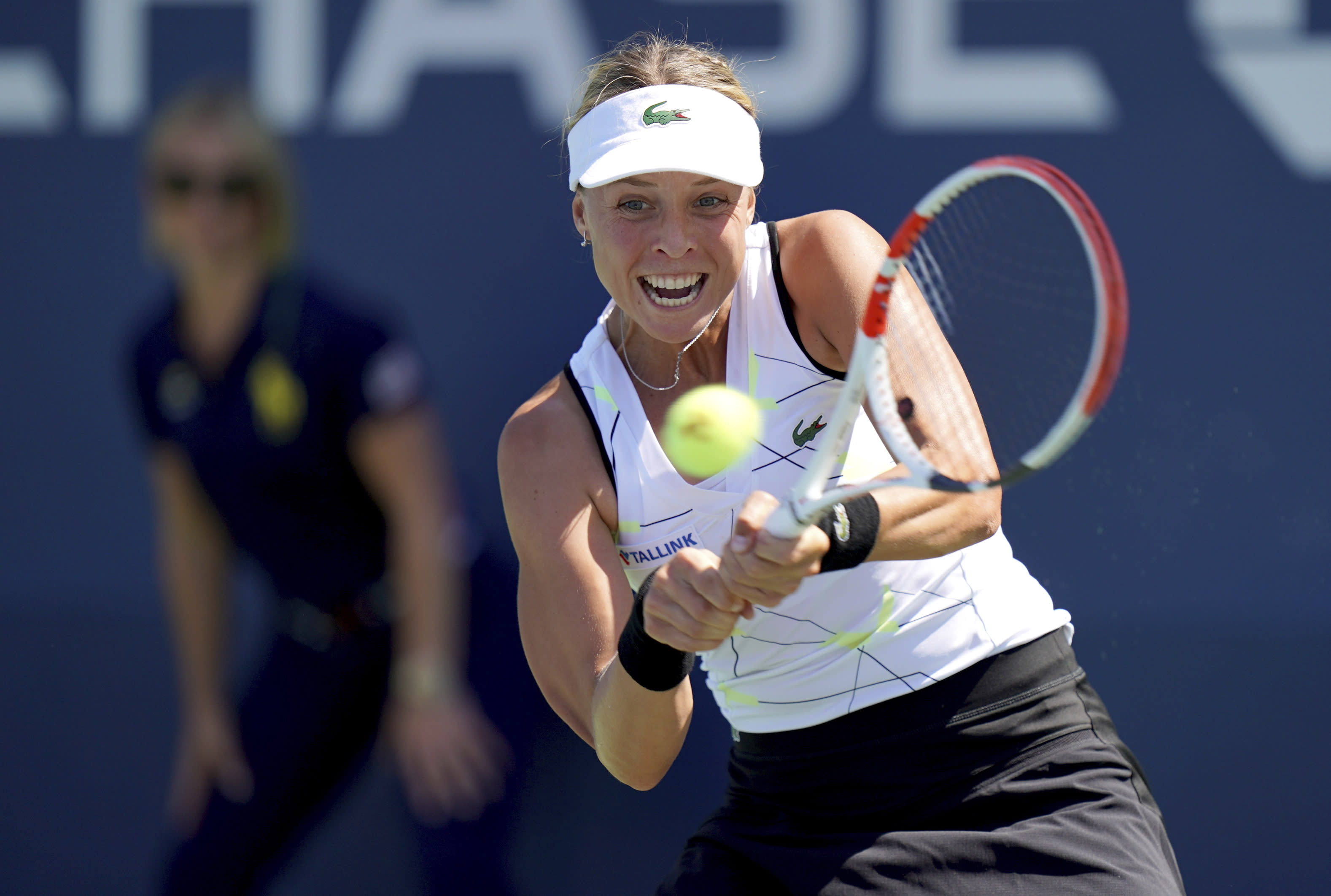 Anna Kontaveit, of Estonia, returns a shot to Anna Tomljanovic, of Austria, during the second round of the US Open tennis championships Thursday, Aug. 29, 2019, in New York. (AP Photo/Michael Owens)